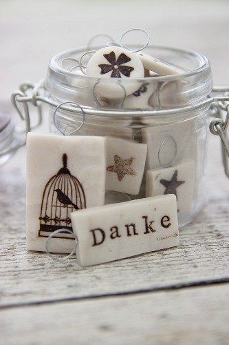 Hand-made polymer clay gift tags in storage jar