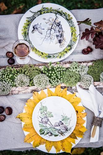 Autumnal arrangement of natural decorations on set table