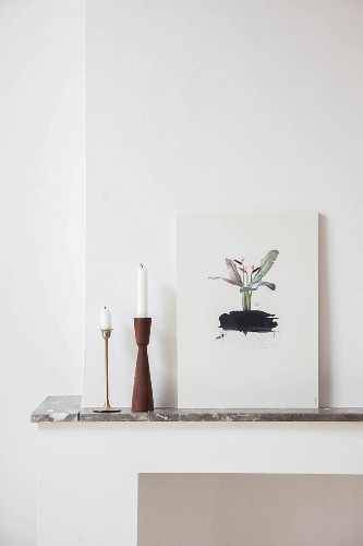 Candlesticks and picture on mantelpiece