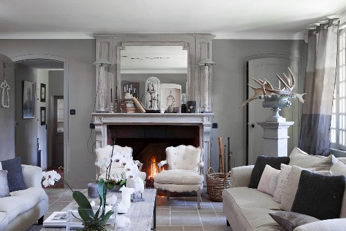 Open fireplace in French-style living room