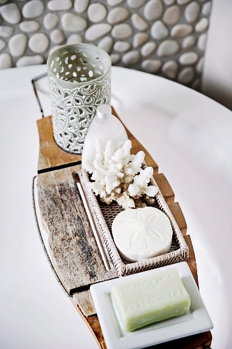 Wooden bathtub shelf with bath accessories and coral