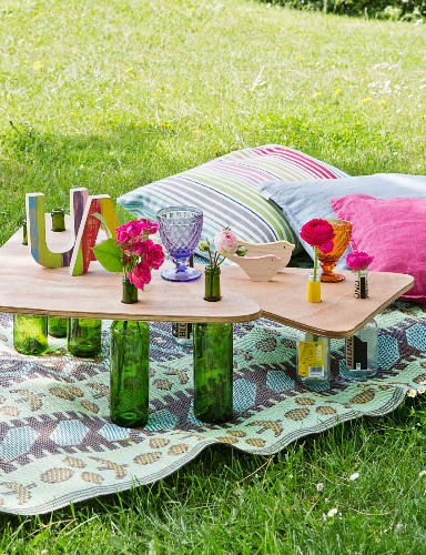 Picnic table hand-made from glass bottles and wooden boards