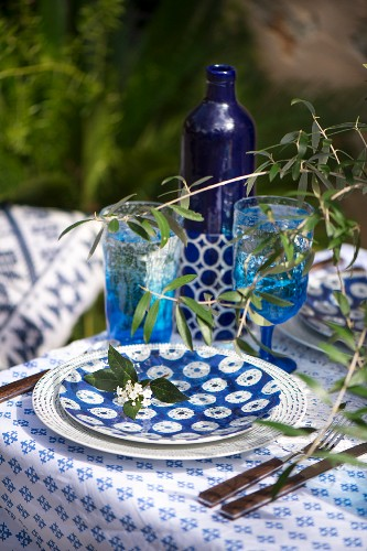 Summer table set with blue and white crockery and twogs