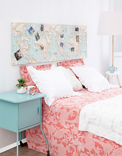 Hand-made headboard covered in world map and photos