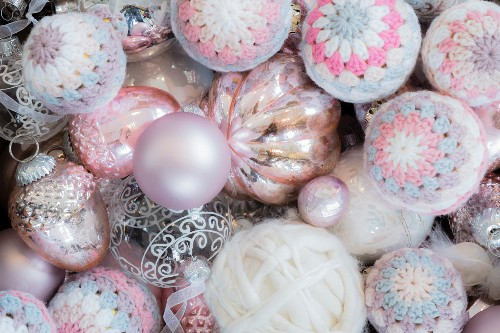 Christmas baubles and crocheted covers and made from pink mercury glass