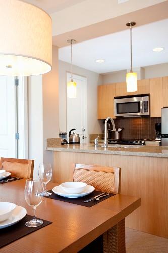 Dining Area and Kitchen of Watermark Beach Resort Luxury Guestroom in British Columbia's Wine Region
