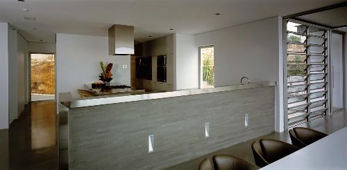 Open-plan, stainless steel kitchen