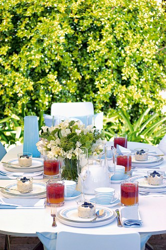 A festively laid table in a garden for brunch