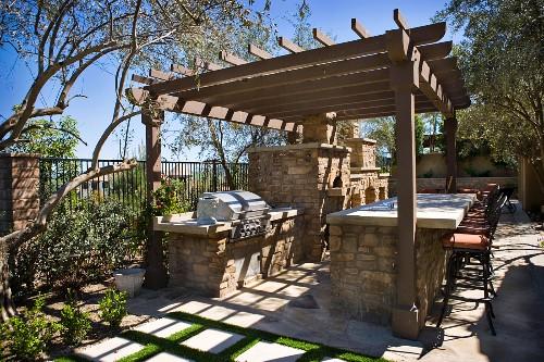 Custom stone backyard bbq grill and bar