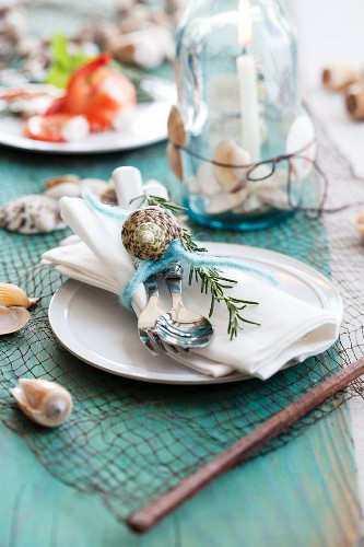 Place setting with seashells and rosemary