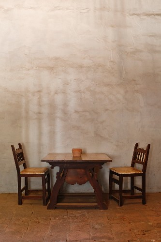 Table and chairs in adobe building at Mission La Purisima State Historic Park, Lompoc, California