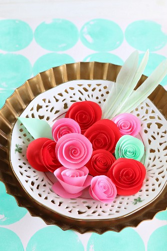 Paper roses in vintage-style dish