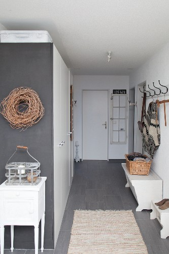 Fitte cupboards and vintage accessories in foyer