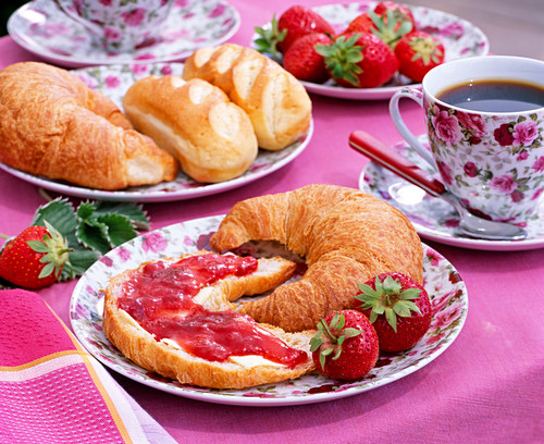 Fragaria strawberries, croissant with strawberry jam, tableware with roses motif