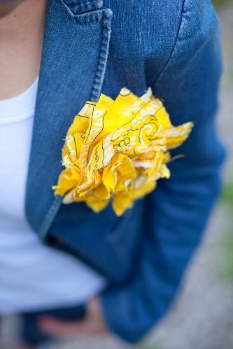 Yellow rosette made from bandana on denim jacket