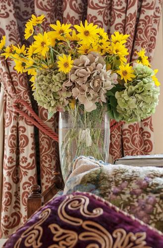 Vase of hydrangeas and false sunflowers