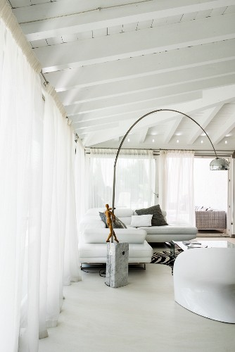 Arc lamp in lounge area with glass walls