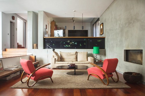 Two red armchairs in interior on multiple levels