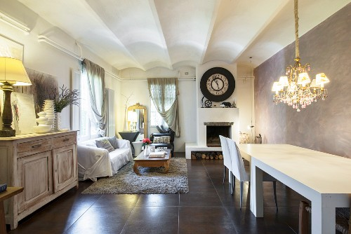 Long dining table in living room in converted wine cellar