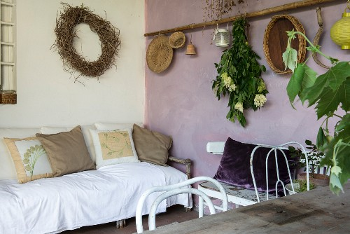 Sofa, dining table and lilac back wall on Mediterranean loggia