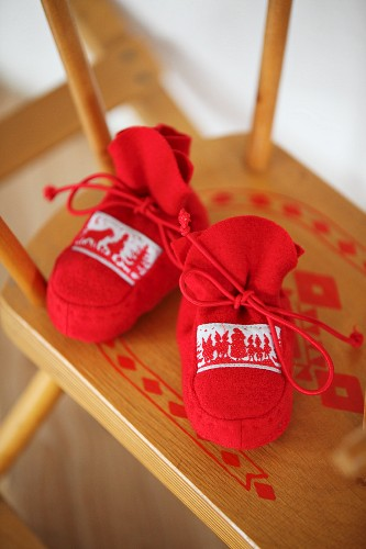 Booties made from red boiled wool with elasticated laces