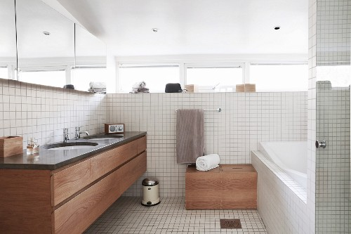 Bright bathroom with white tiles and fitted washstand