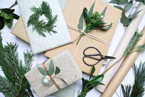 Decorating Christmas presents with twigs and leaves