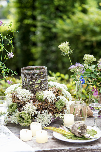 Set table decorated with wildflowers in garden