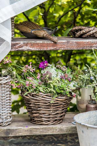 Bouquet of wildflowers in weathered wicker basket