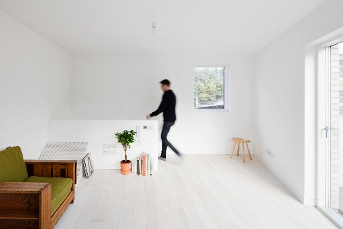 Bright attic room with white wooden floor