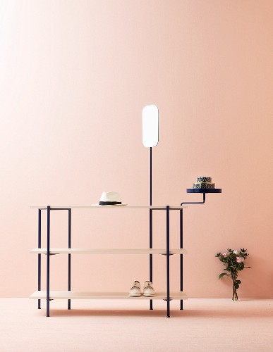 Delicate shelves against pink wall