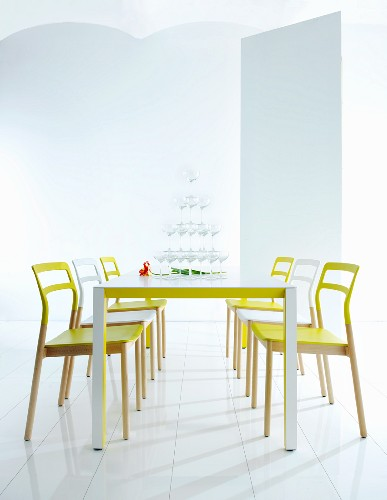 Modern dining area with neon furniture and pyramid of glasses