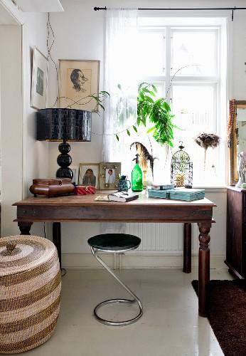 Modern chrome stool at rustic desk