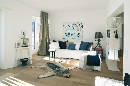 Wolf-skin rug on floor of wintry living room