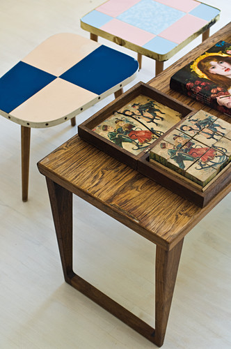 Wooden puzzle in wooden box on retro coffee table