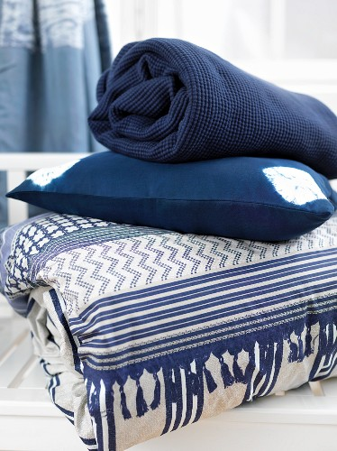 Blue and white quilt, cushion and blanket