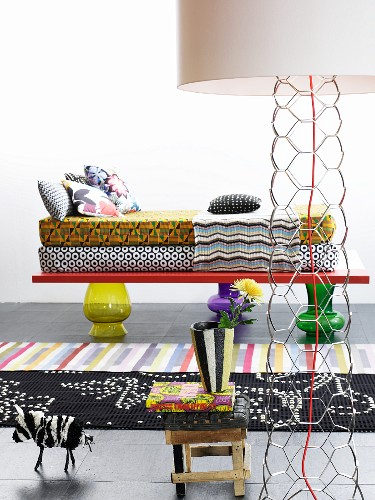 DIY divan made from various mattresses and cushions