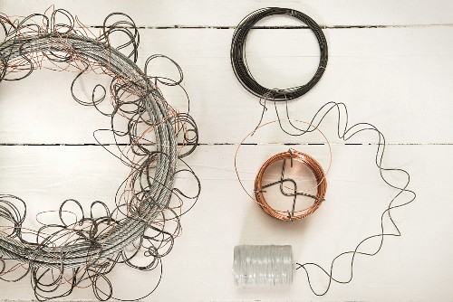 Arrangement of cables and copper wire on white surface