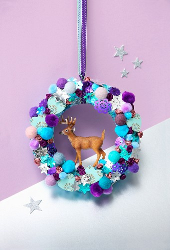 Stag figurines in colourful wreath of pompoms