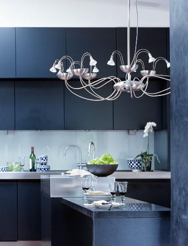 Modern chandelier in elegant kitchen