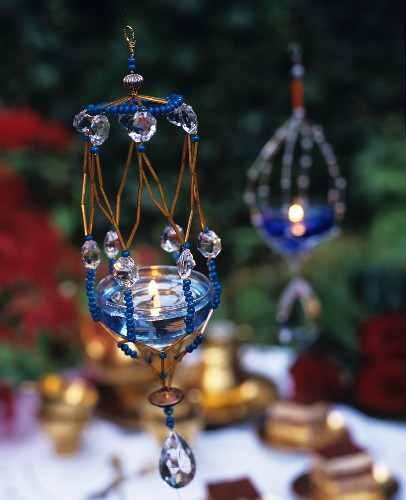 Atmospheric garden decorations: Gel candles in suspended holders decorated with beads and crystals