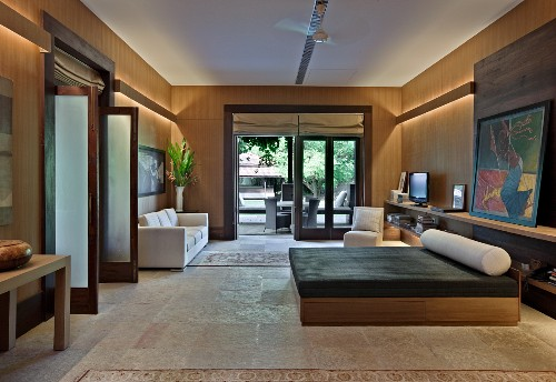 Modern bedroom with wooden walls and terrace