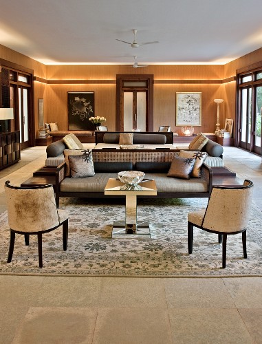 Elegant living room in shades of brown with indirect lighting