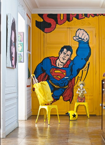 Mural of Superman painted on panel door in period apartment