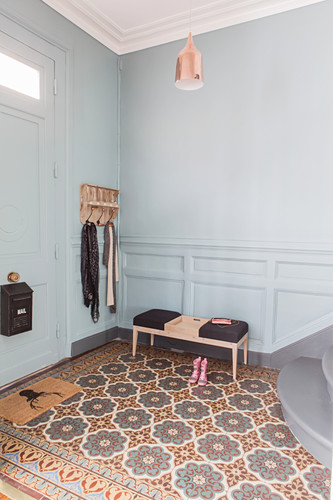 Bright hallway with colourful cement floor tiles