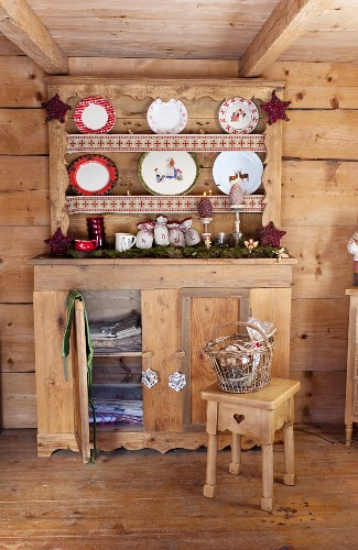 Rustic wooden cabinet and plate rack in wooden cabin