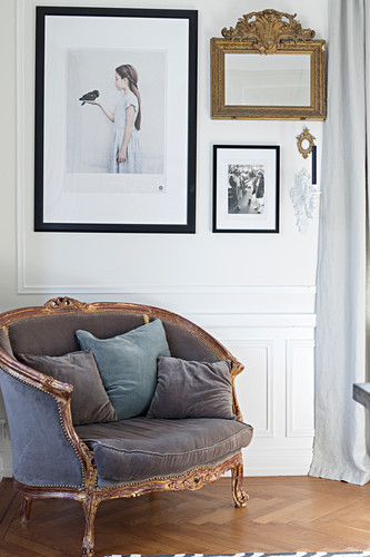 Baroque armchair with velvet upholstery against panelled wall