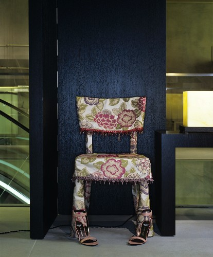 Hand-sewn floral chair cover with fringed trim