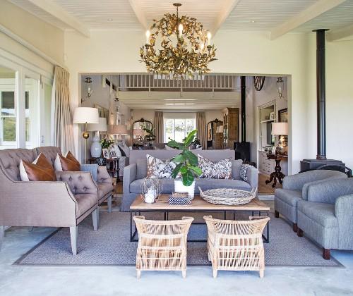 Comfortable upholstered furniture in elegant open-plan lounge