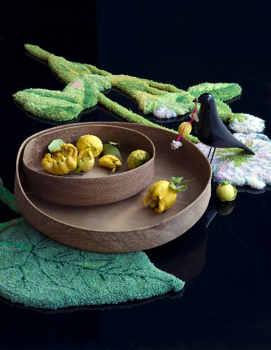 Lemons on wooden trays on leaf-shaped rig